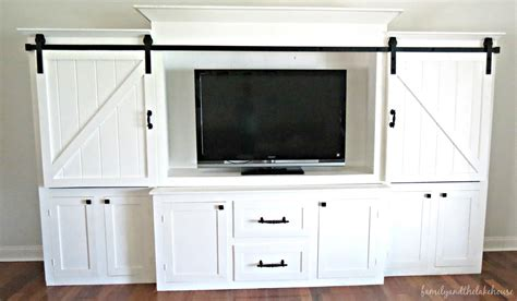 white barn door entertainment center family and the lake house she s here welcome home