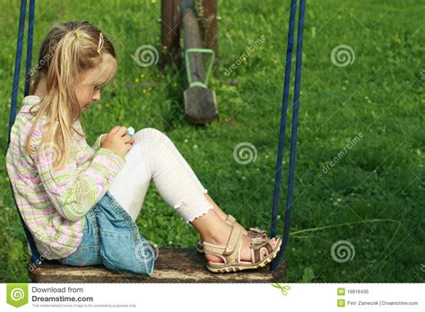 little girl on swing little girl on a swing stock photo image of green