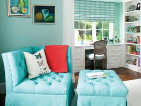 Bedroom sitting area with blue corner chair and ottoman a blue bedroom