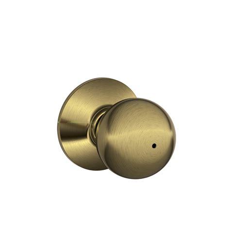 Privacy Door Knob by Shop Schlage F Orbit Antique Brass Push Button Lock