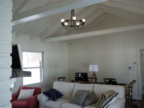 paint wood paneling white paint paneling cabin diy