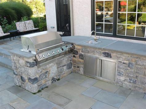 bluestone countertop outdoor kitchen with bluestone patio traditional patio philadelphia by stone creek