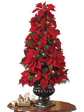 Poinsettia Tree Rack by 1000 Ideas About Poinsettia Tree On