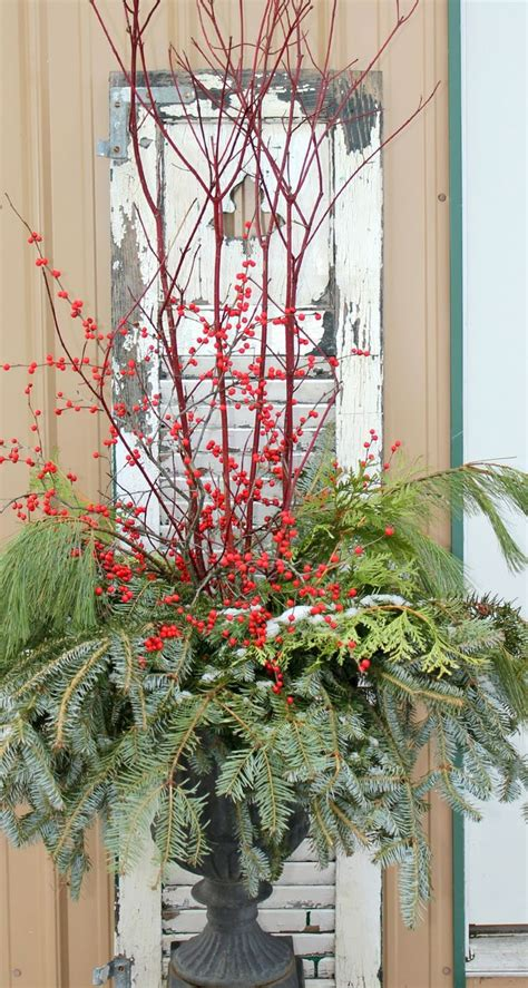 garden urns with greenery and berries christmas ideas