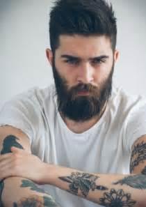 2016 hair and fashion slick back haircut beard tattoos men s hair trends