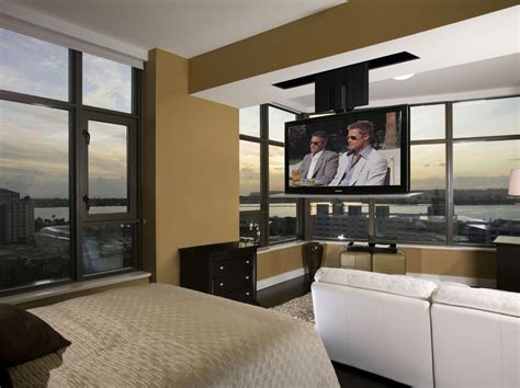 Ceiling Drop Tv Lift by Ceiling Tv Dropping A Tv From The Ceiling Saves Space Nexus 21