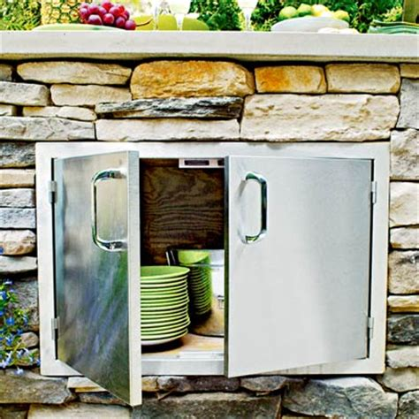 Outdoor Kitchen Cabinet Doors by An Outdoor Kitchen Island With Stainless Steel Storage