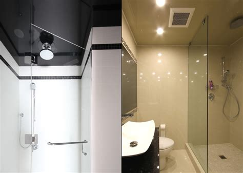 stretch ceiling in two modern bathrooms modern