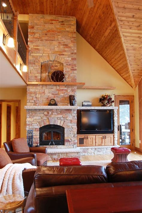 stone tall fireplace arched niche wood stone floating shelving entertainment center rustic beech cabinets living spaces tr