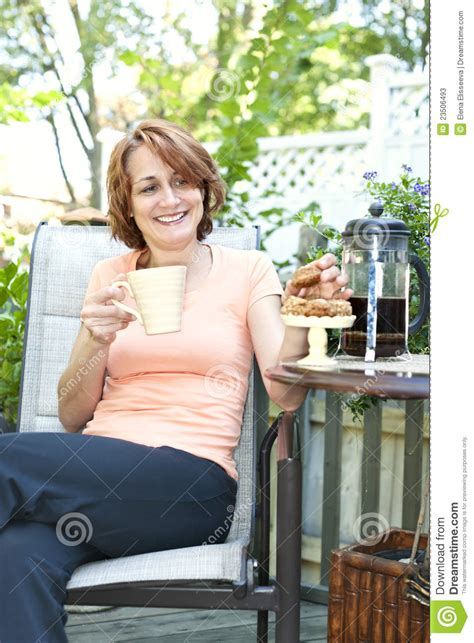 woman  backyard  coffee  cookies stock