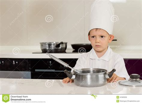 Standing In The Kitchen by Serious Looking Chef In The Kitchen Stock Photo