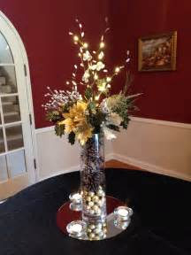 Vase Centerpieces With Lights by Themed Centerpiece Used To Decorate Entrance At
