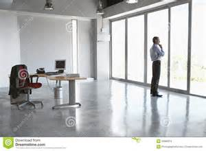 Church Floor Plans Free man looking out of glass door in empty office stock images