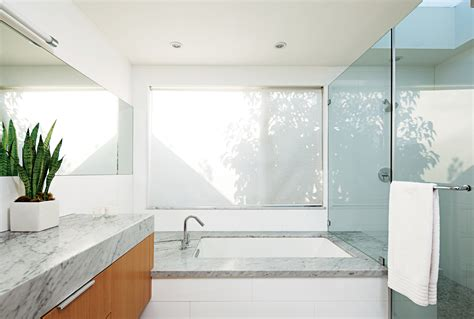 glossy glass material in minimalist bathroom with small