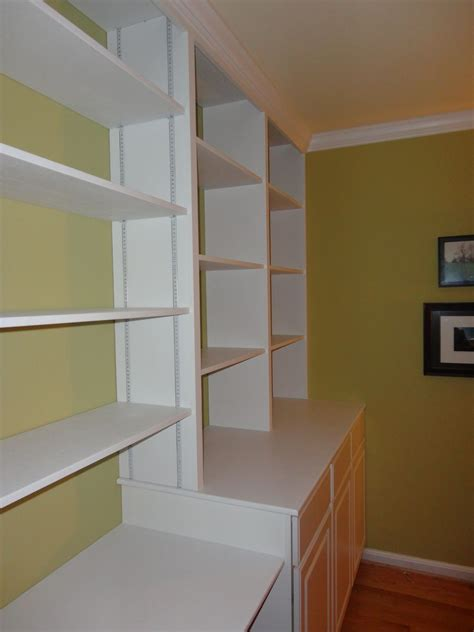 hand crafted custom wall adjustable shelving with crown