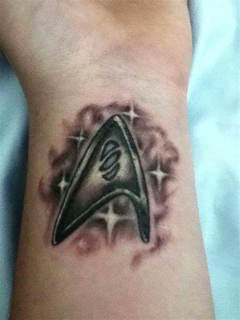 tattoo star logo shinning star trek logo tattoo on wrist