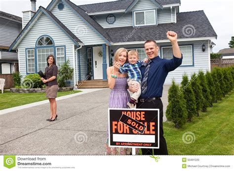their home young family celebrate new house purchase outside stock