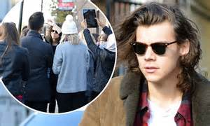 harry styles verified fan code harry styles mobbed by fans but stops for selfies with