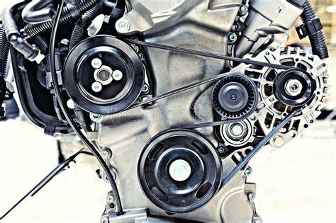 Motor Fan Ac Condensor Kondensor Toyota Yaris Suzuki Escudo 1 6 Merk pulleys with belt in the car motor stock photo image of