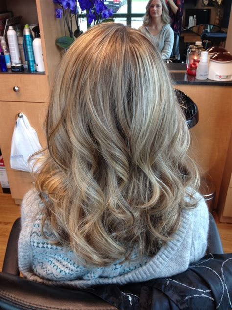 pictures of blonde highlights and lowlights curly blonde highlights and lowlights curls hair by melissa