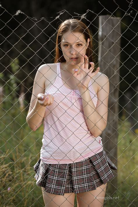 fame net models beautiful girl grabbing the steel net fence pink tes and