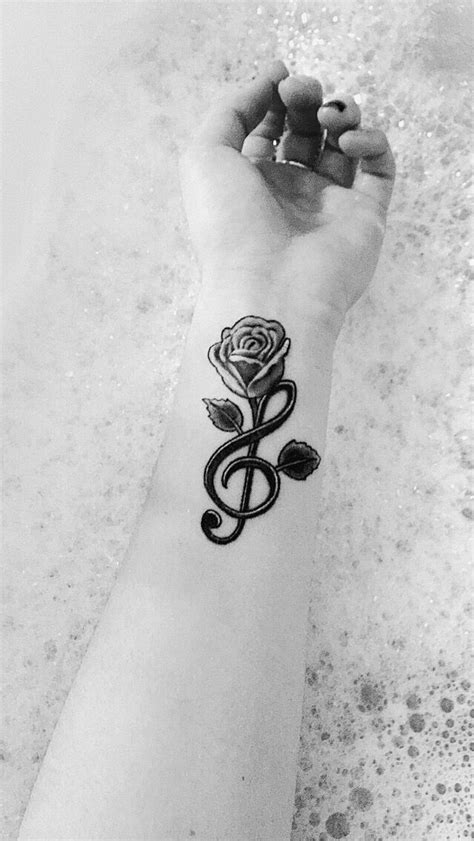 treble clef with rose tattoo my treble clef a growing out of it