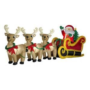 airblown santa in sleigh with three reindeer