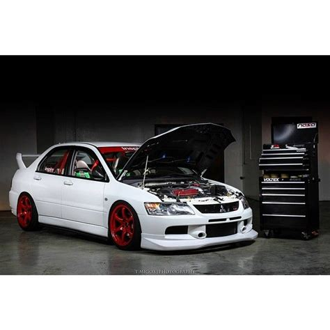 mitsubishi evo red white mitsubishi evolution with red wheels modified