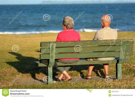 old people on a bench retired couple sit on a bench stock photo image 49710175