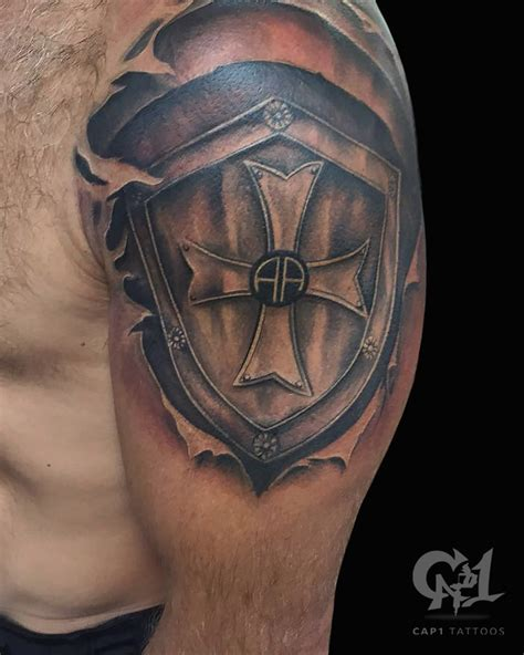 cross shield tattoo shield of armor shoulder tattoobycapone