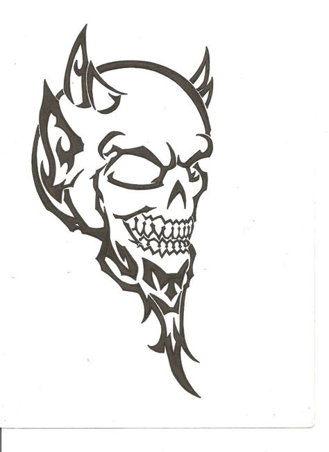 fine black ink tribal devil skull tattoo design by the