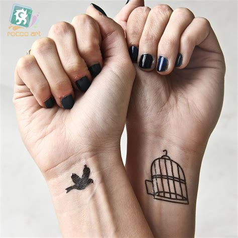 bird cage wrist tattoo bird cage wrist