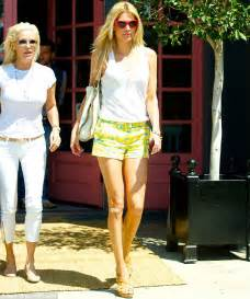 youlanda foster white tee shisrt brandi glanville highlights her long slender limbs in tiny