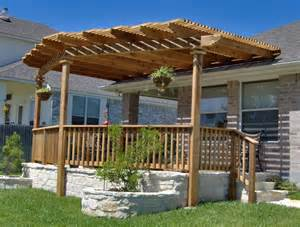 exterior backyard patio pergola ideas design with wooden rail half fencing on white stone like