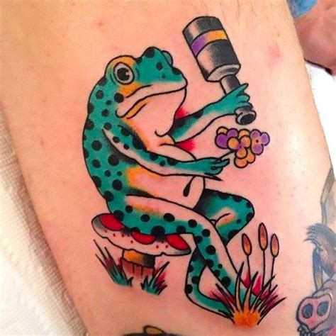 cartoon frog tattoo designs frog with flowers idea