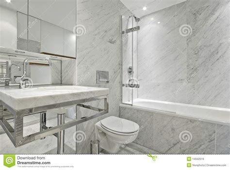 Shower Bath Mixer Tap modern en suite marble bathroom in white royalty free