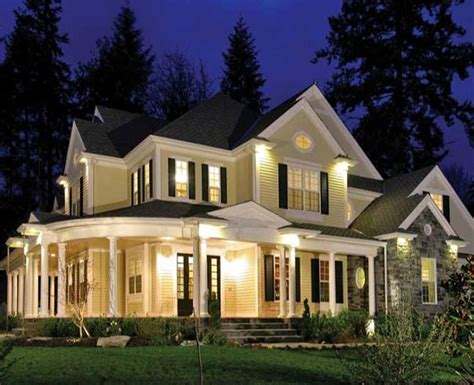 southern custom homes a large wrap around front porch welcomes you to this