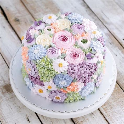 Buttercream wedding cake covered in flowers by Indonesian