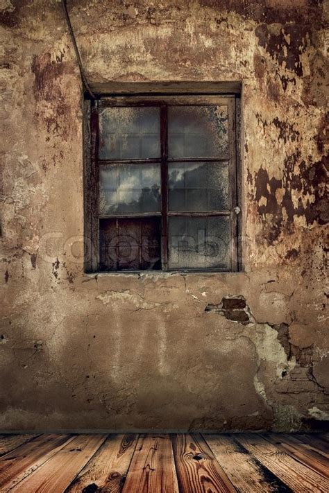 Room in an old abandoned house with grunge wall and wooden