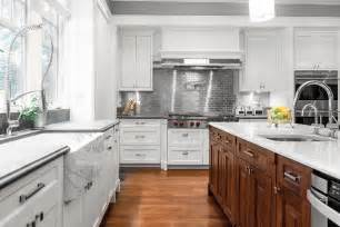 white kitchen cabinets with stainless steel subway tile silver chrome stainless steel backsplash arched mosaic