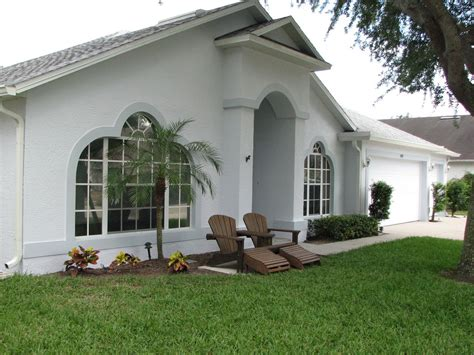 painting a merritt island homes exterior stucco walls and doors before and after