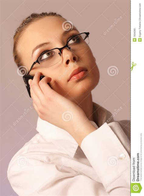 mobile strike girl with glasses girl in glasses and with a mobile phone stock photos