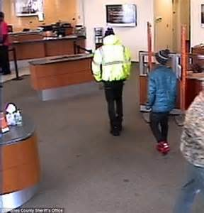 who allegedly tried to a rob a bank with a child gives