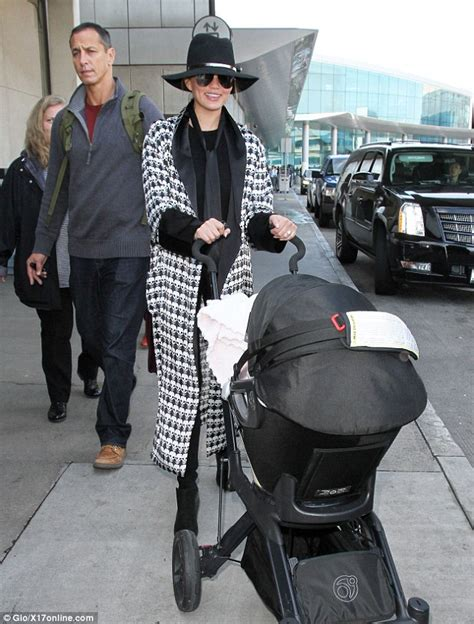 Thursday Three City Move To The Country by Chrissy Teigen Arrives At Lax In A Coat And Tie As She