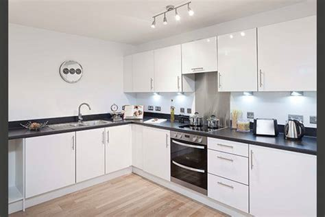 glossy white kitchen cabinets specification kitchens manhattan fitted kitchen with grey laminate worktop upstand