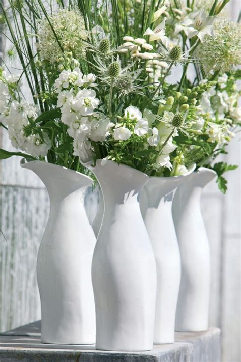 jarrones de cristal con flores
