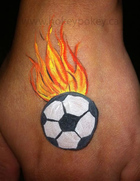 soccer ball with flames boy s face painting by let s arm cheek painting galery face painting toronto face