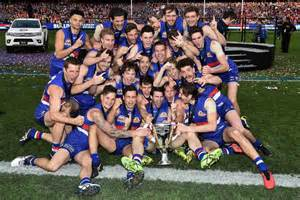 Bulldogs celebrate with afl premiership trophy abc news australian
