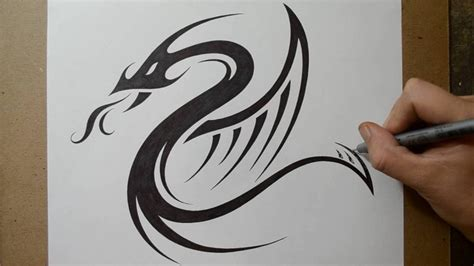simple tribal dragon tattoo designing a tribal serpent design