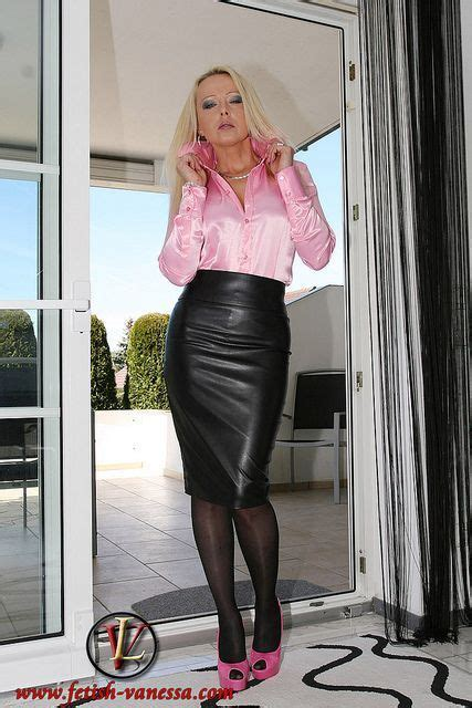 pink satin blouse and black leather pencil skirt and pink